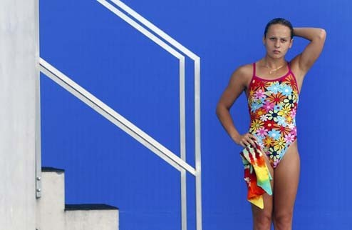 Ukraine's Pysmenska looks at scoreboard after competing in preliminary round of women?s 1m springboard diving event at 14th FINA World Championships in Shanghai